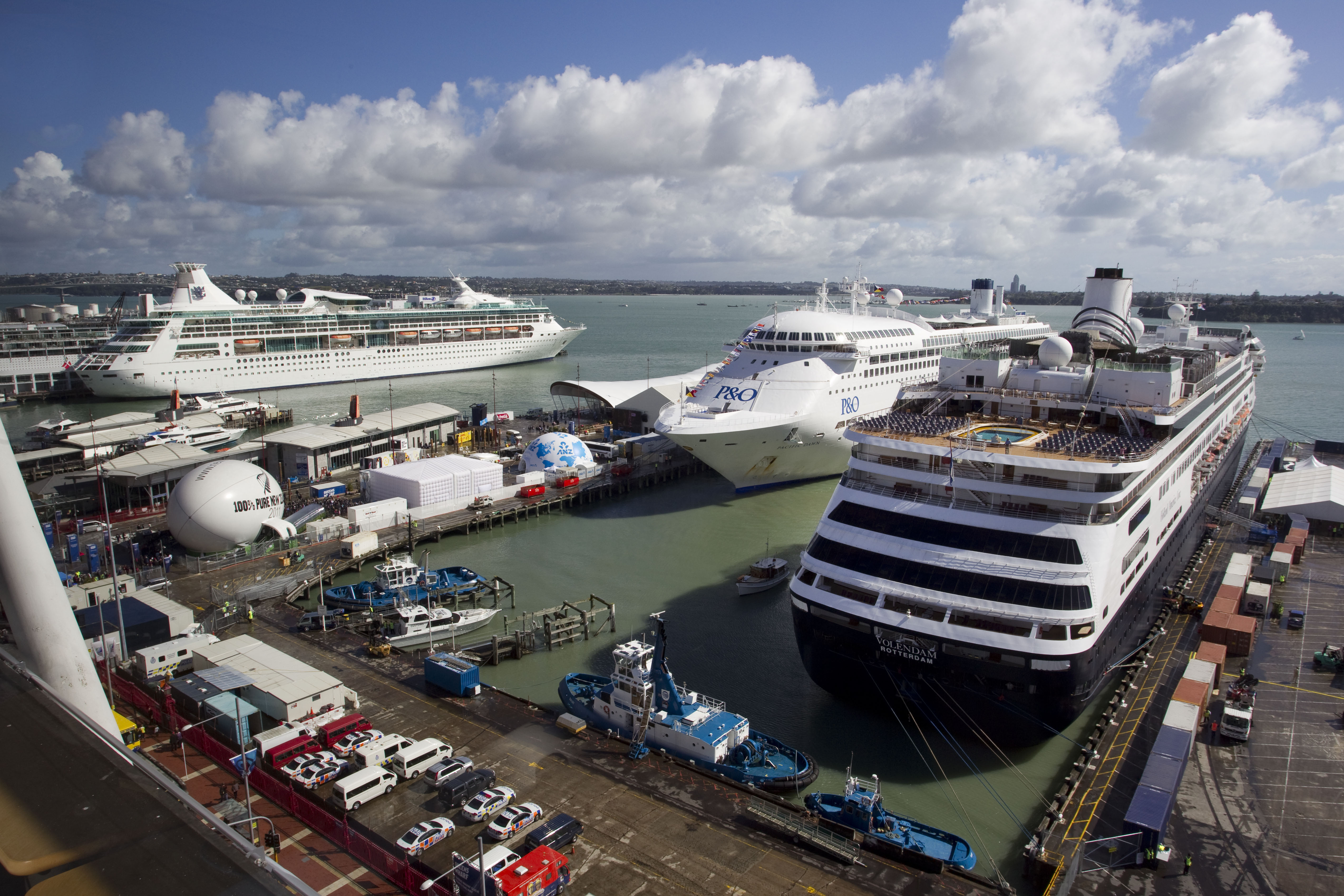 Three cruise ships - one each at Capatain Cook, Queens and Princes Wharves.