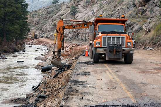 Construction crews begin cleanup on Hwy US 36 in Colorado following the September 2013 floods.